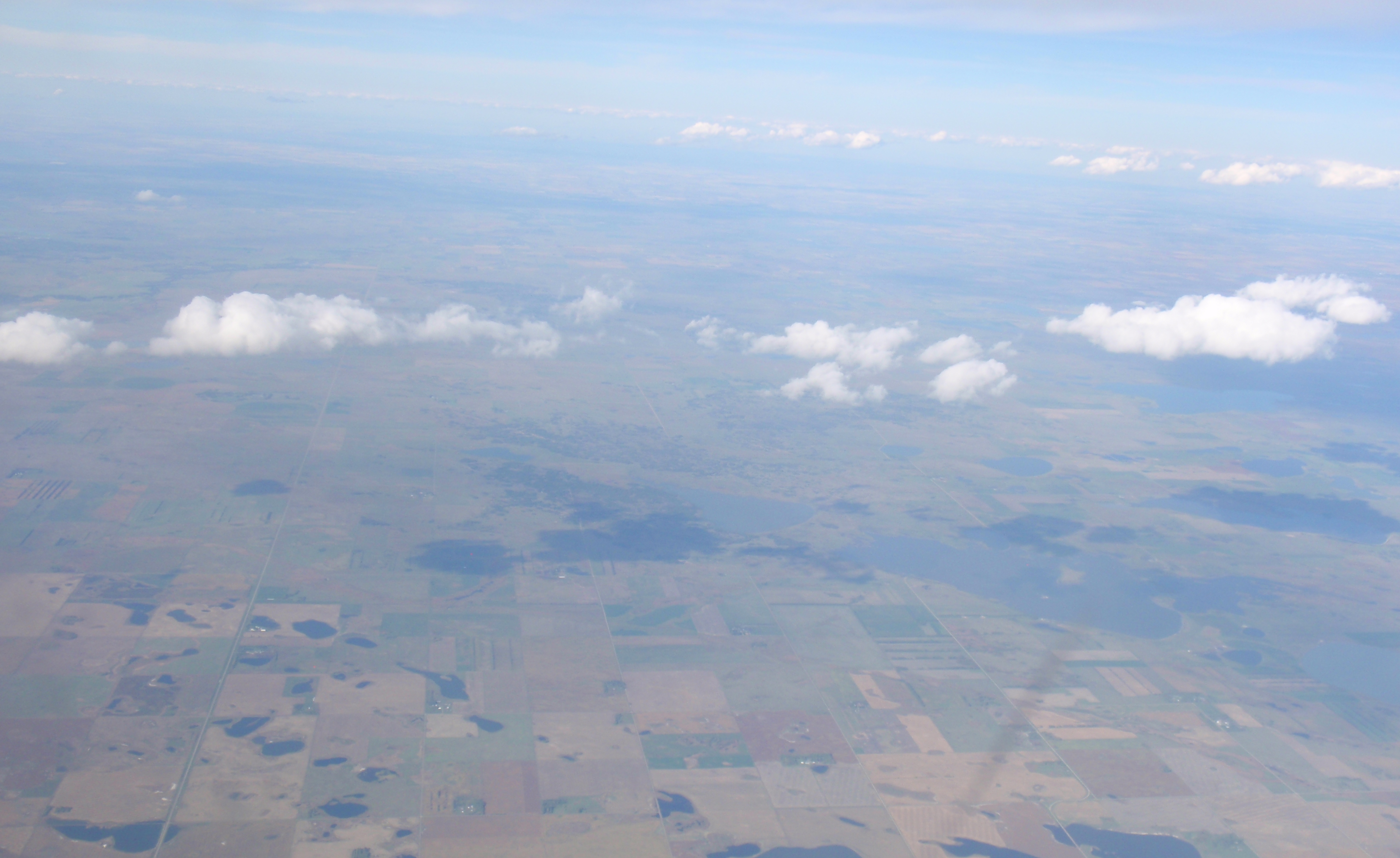Lots of wells down there, but not a mountain in sight on flight back to Minneapolis. Photo by James Ulvog.