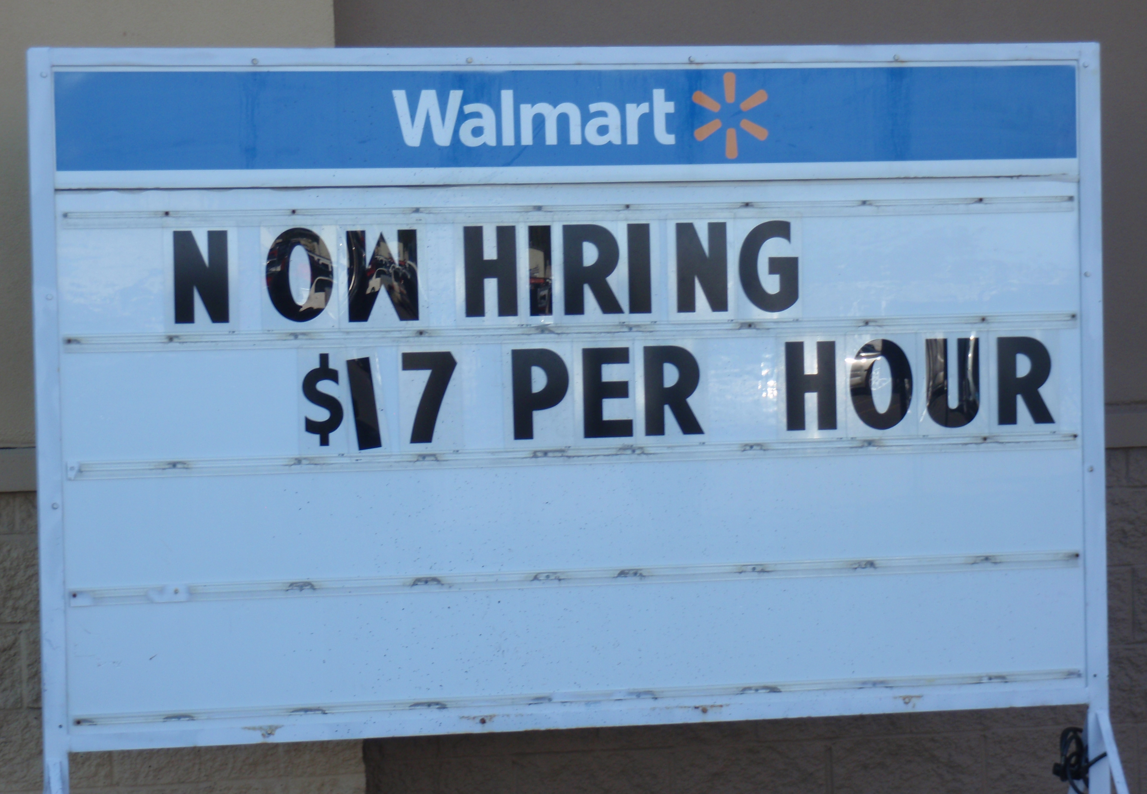 Sign outside Williston Walmart on 9/20/15. Defacto minimum wage in town is still $17 an hour. Photo by James Ulvog.