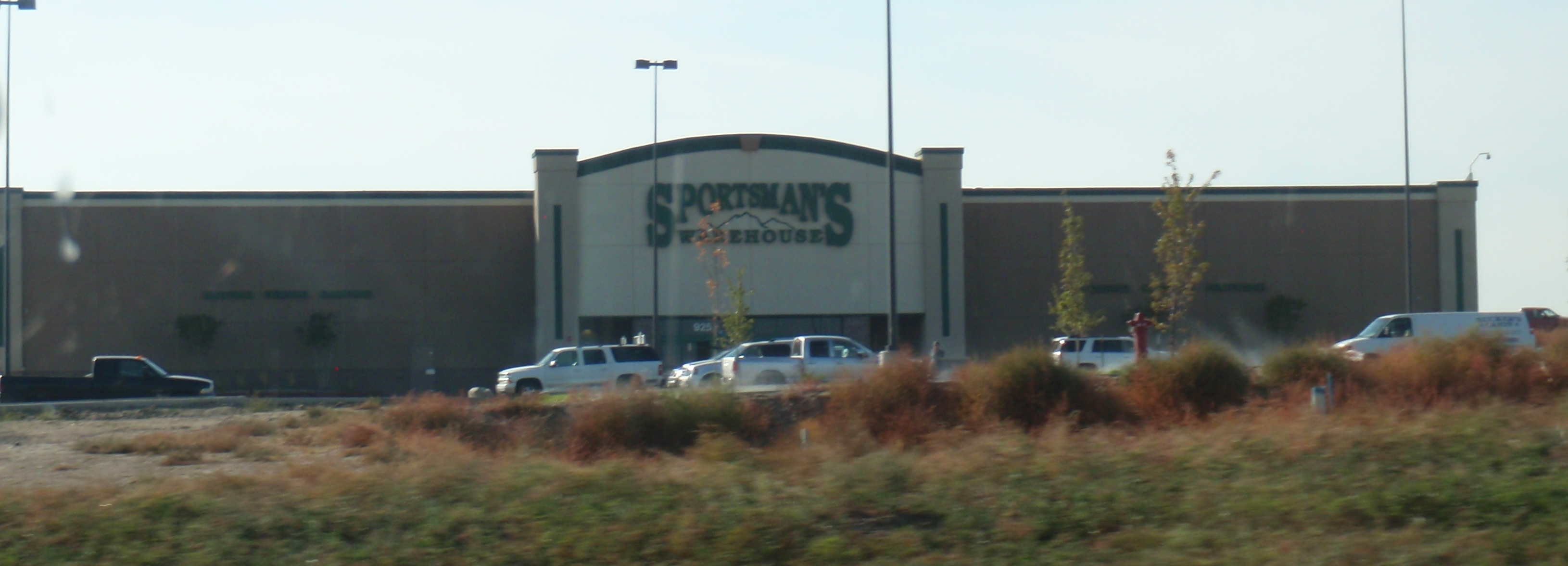 Huge, new Sportsmans' Warehouse store in WIlliston. Huge amount of apartments under construction behind the store. Photo by James Ulvog.