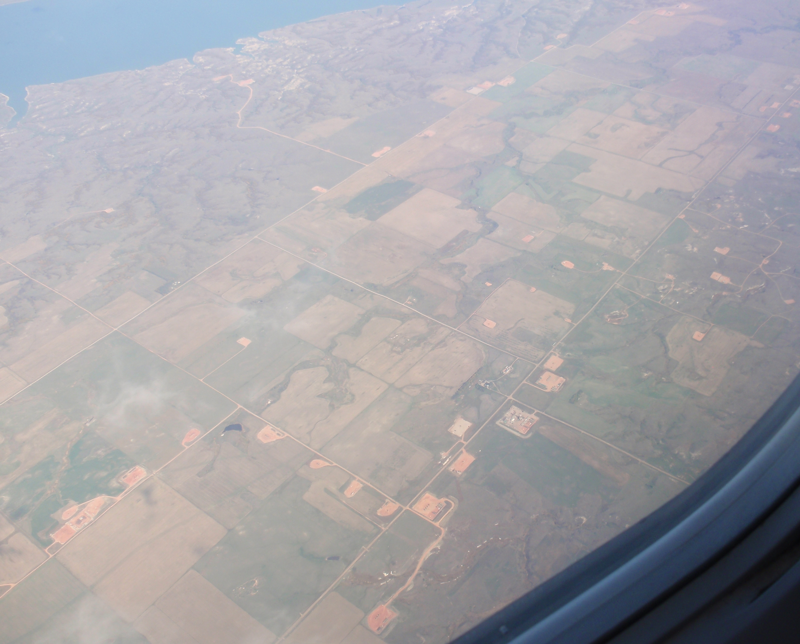 Each of those little brown spots is a well pad with 1 or 4 wells, each of which can produce around half a million barrels of oil that was completely unrecoverable two decades ago. Photo by James Ulvog.
