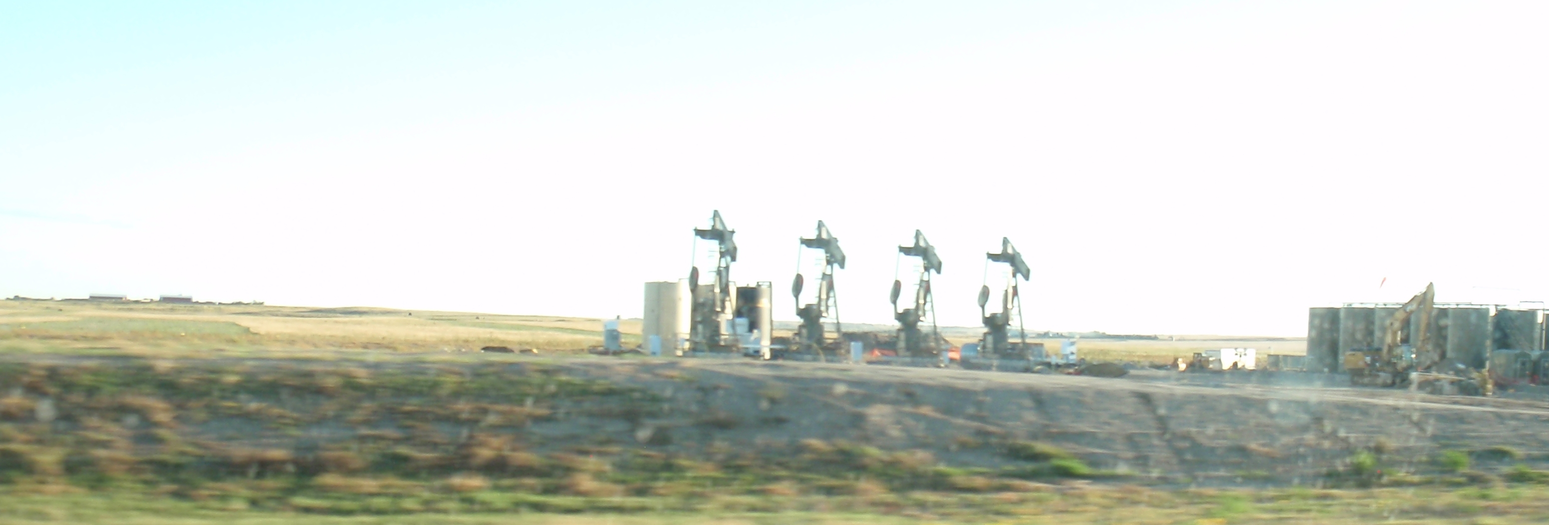 Pumpjacks about ready to come online in North Dakota. Photo in October 2015 by James Ulvog. Not what OPEC planned.