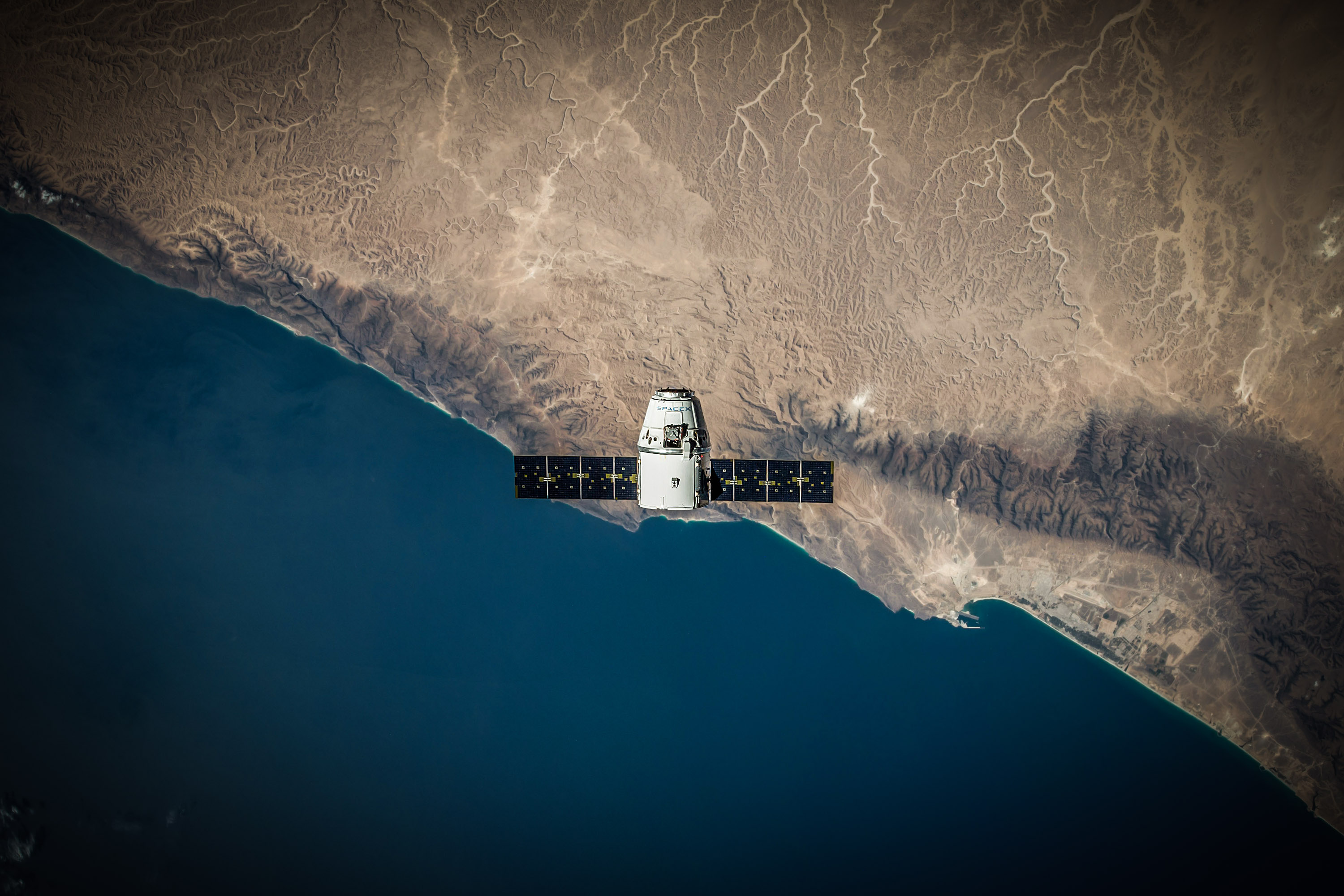 SpaceX Dragon capsule in orbit. Photo by SpaceX released to public domain.
