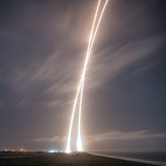 Trail of Falcon 9 launch and successful recovery. Photo courtesy of SpaceX released to pubic domain.