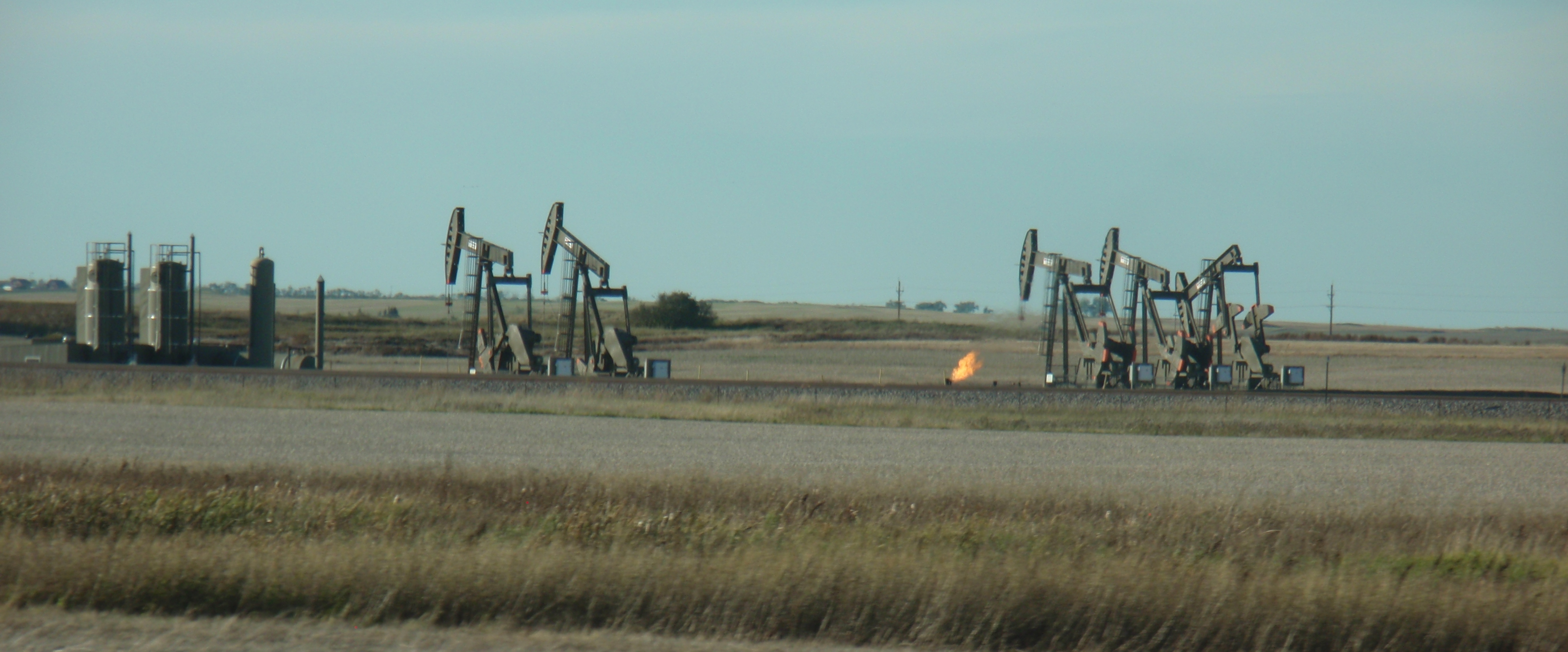 Many more wells will be on that site when all the drilling is done. Slight flaring as photo taken by James Ulvog.