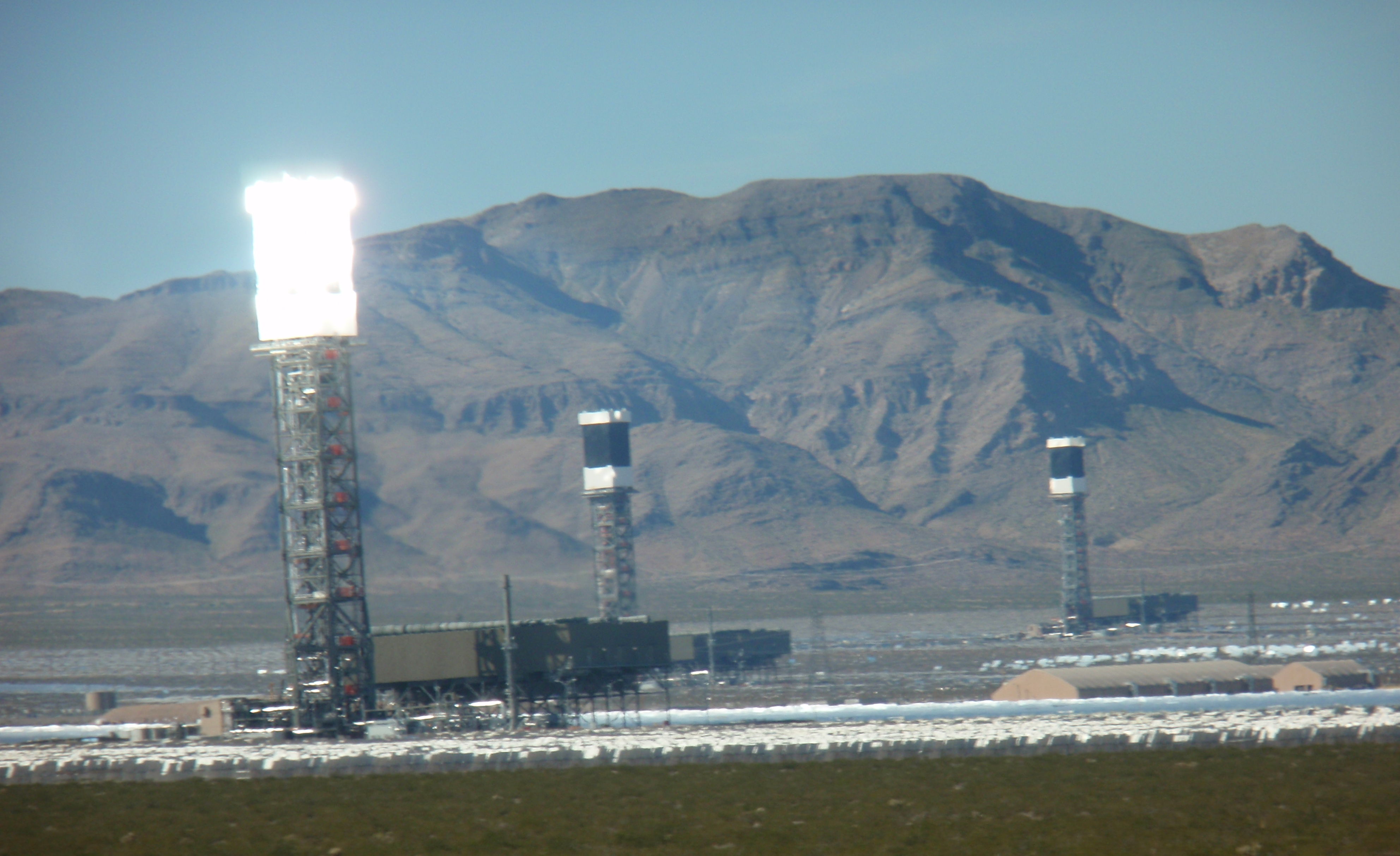 Only one of the three Ivanpah towers is burning the wings off birds at the moment this picture was taken in 2013. Photo by James Ulvog.