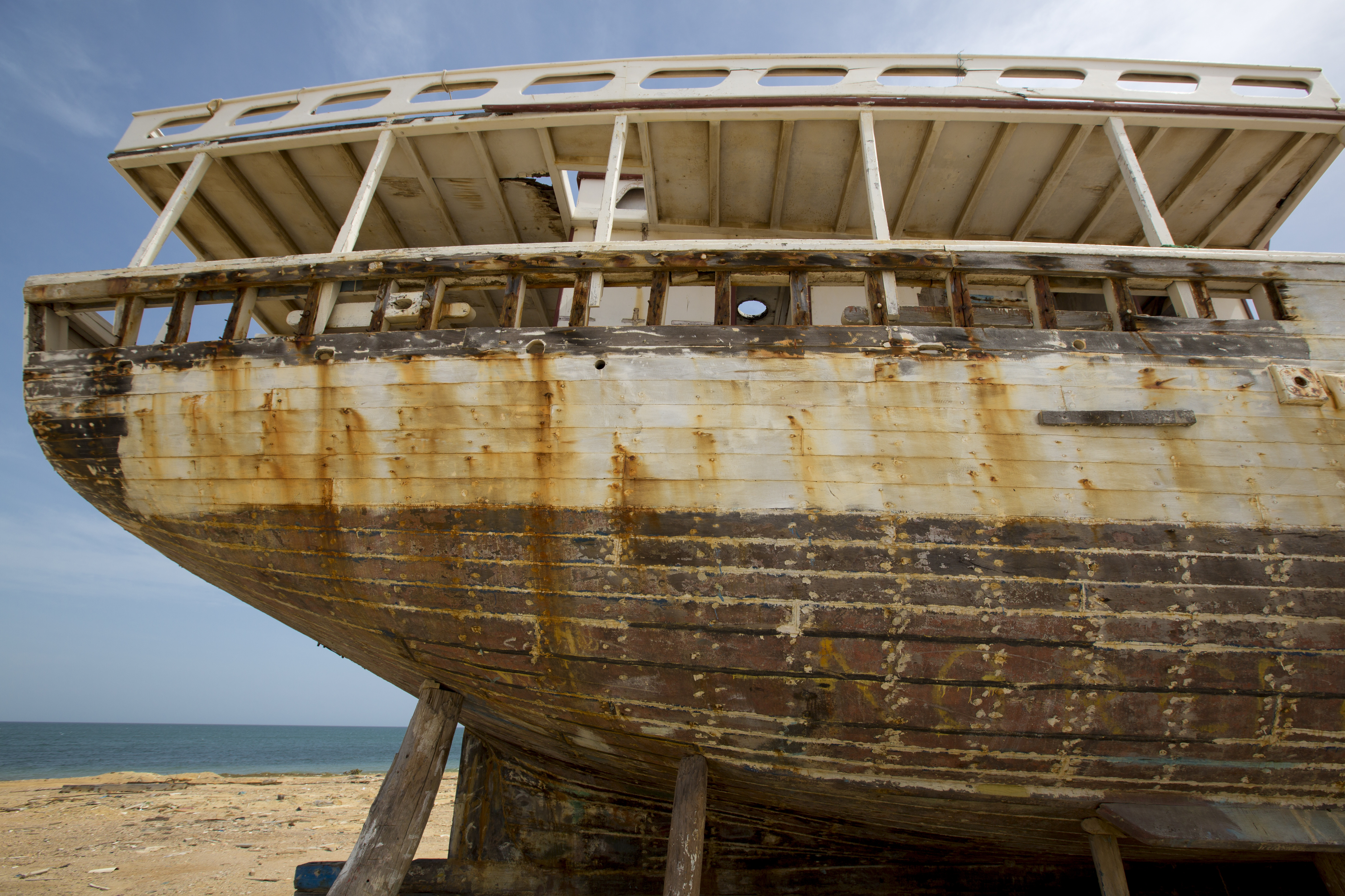Shipwreck standing on the beach with the sea in the background. Margarita Island. Venezuela. Photo courtesy of DollarPhotoClub.com