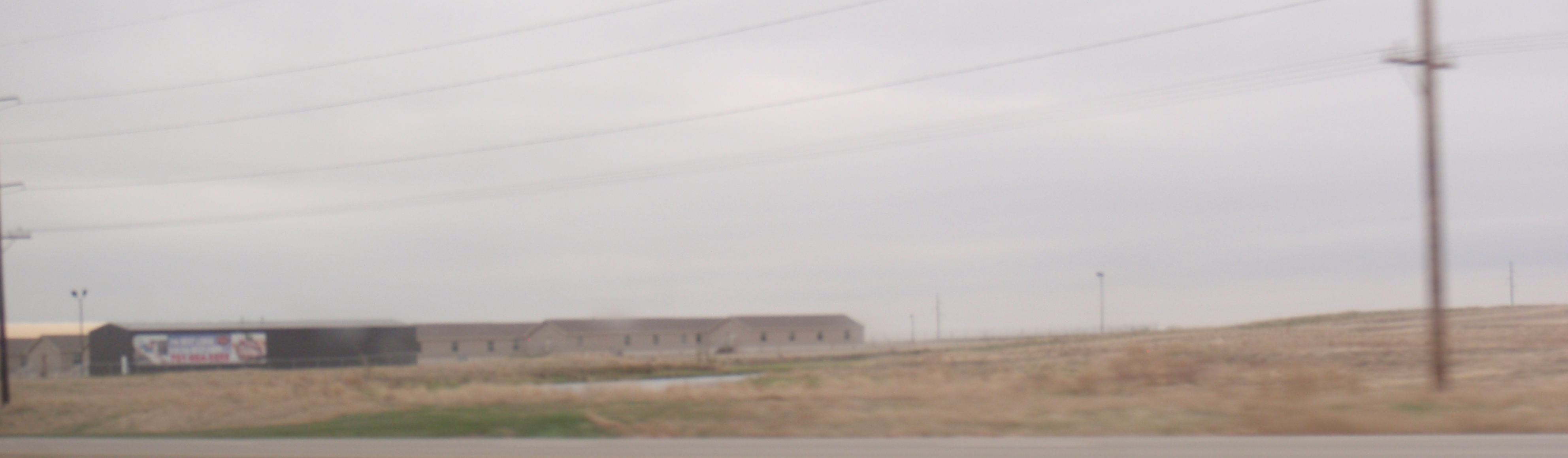 Lousy photo by James Ulvog of a man camp near Ray, North Dakota.