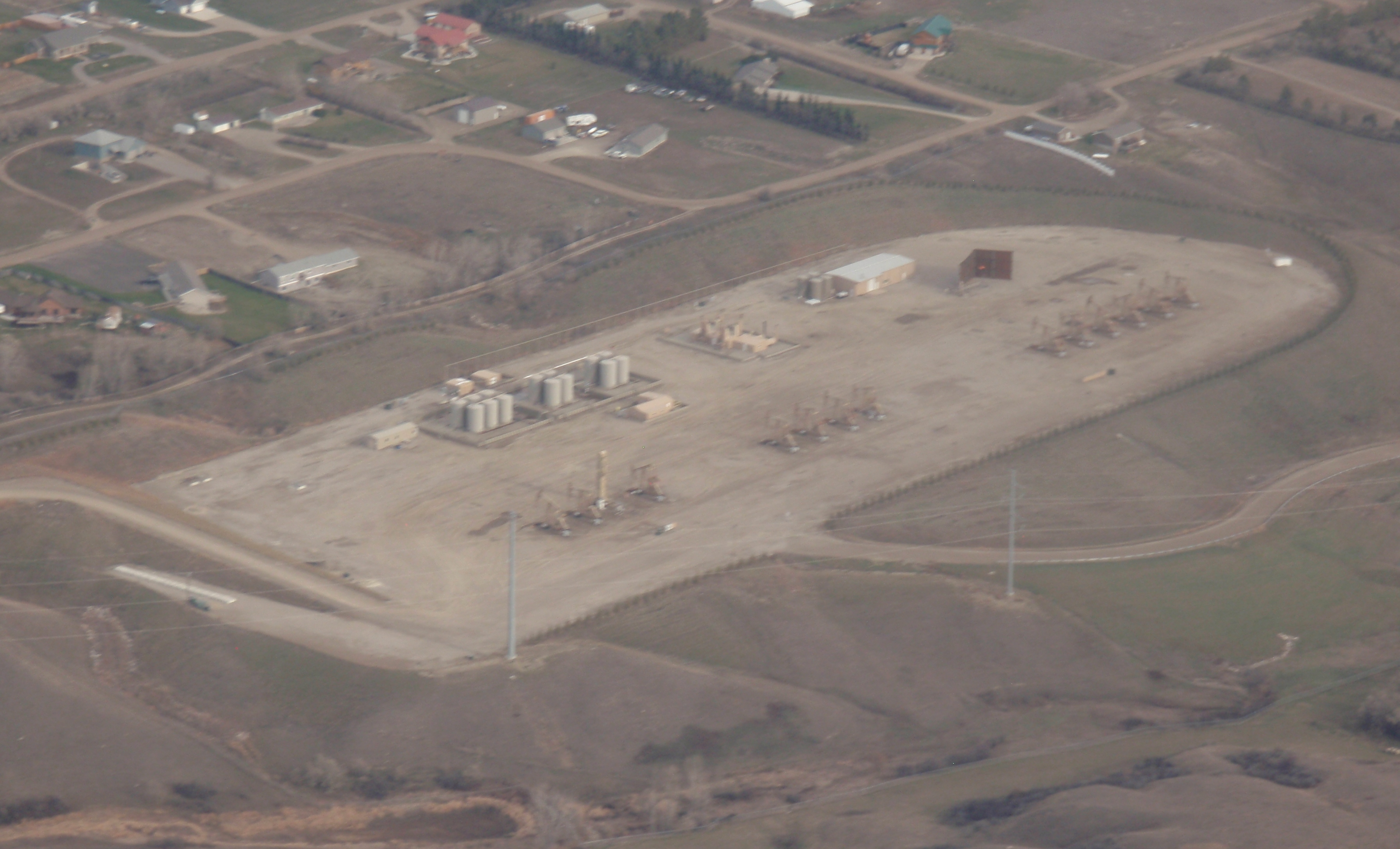 14 wells on one pad, southwest of Williston. Photo by James Ulvog.