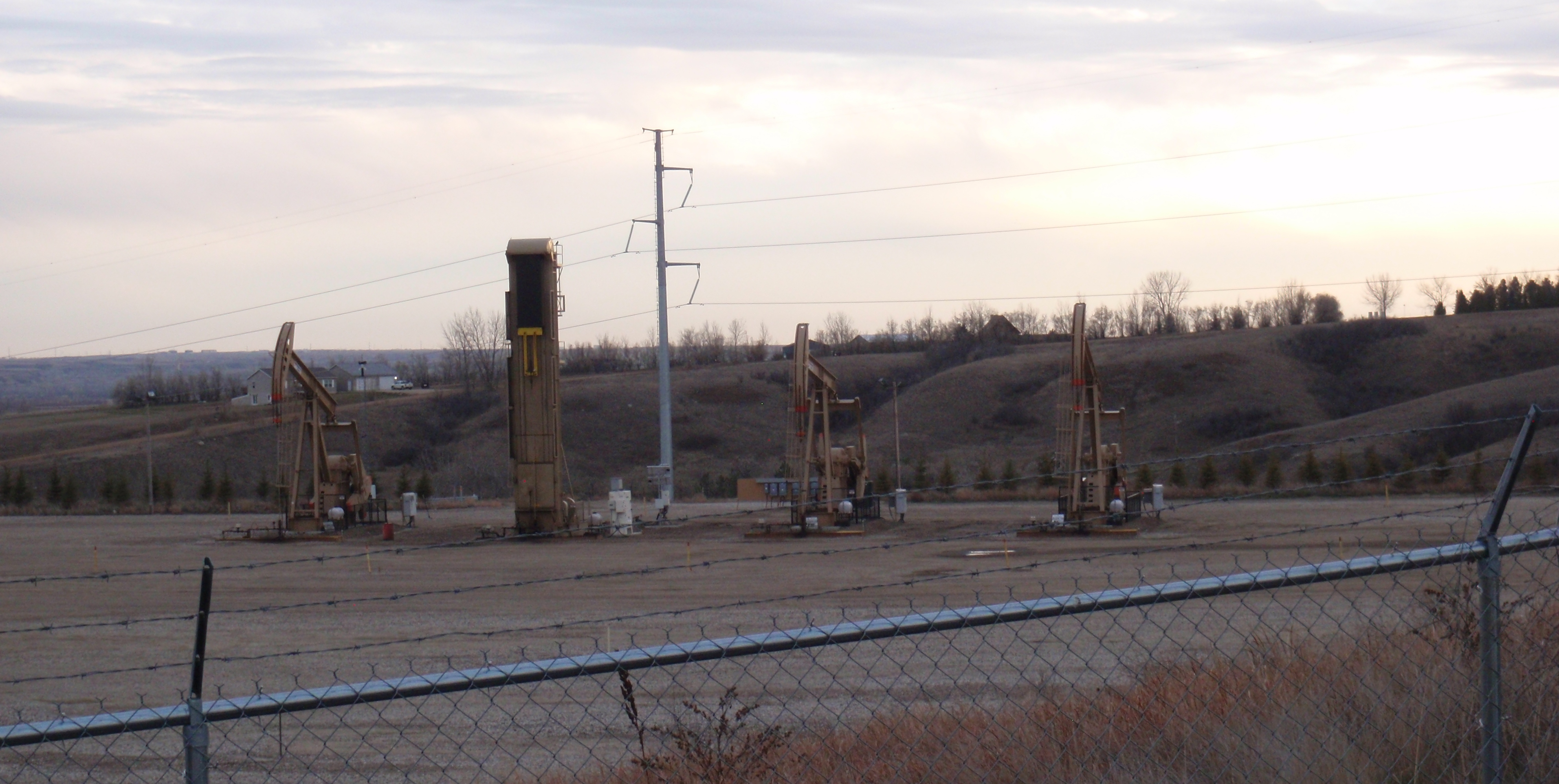 4 wells on west side of pad. Notice one pump isn't typical donkey style. Photo by James Ulvog.