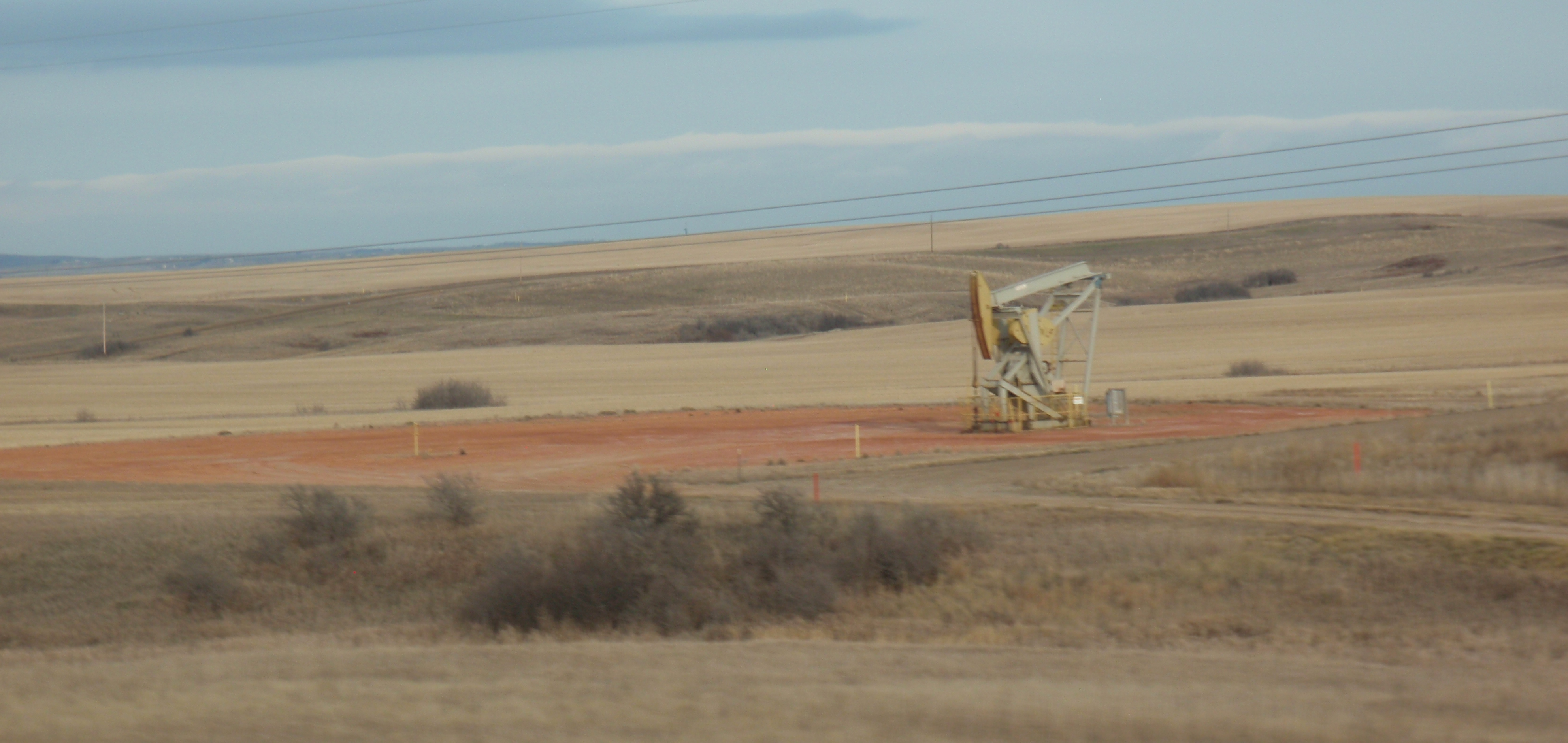 In a decade or so, will we get to see thousands of these above the Green River Formation? Photo of Bakken pump jack by James Ulvog.