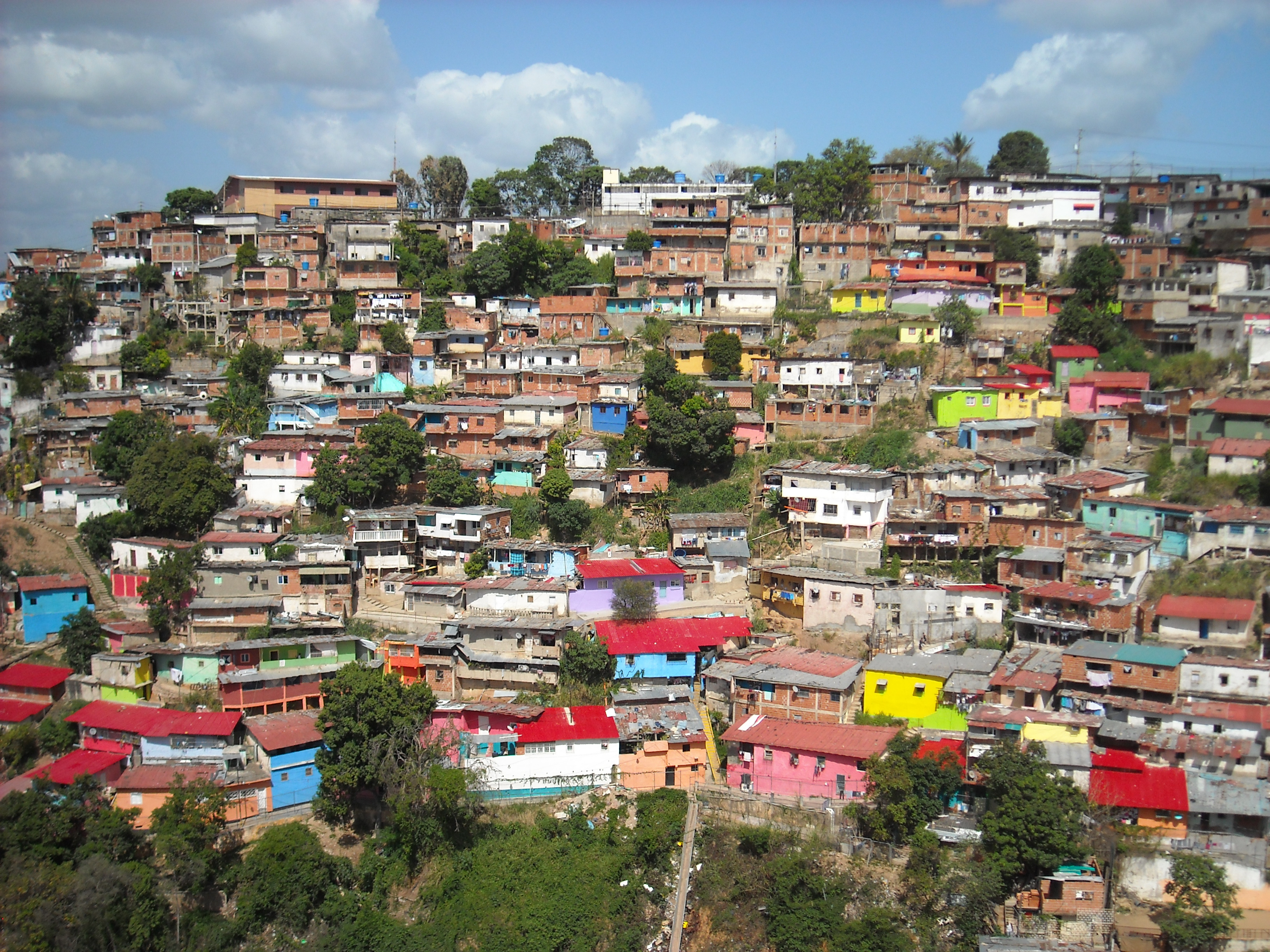 The poor living in those houses in Caracas are suffering greatly as a result of intentional government policies. Photo courtesy of Adobe Stock.