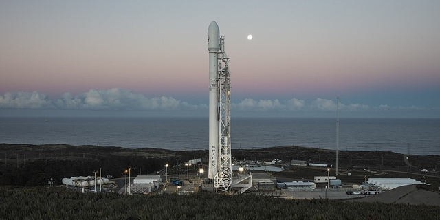 Falcon 9 at Vandenber SLC 4E, ready to life 10 Iridium satellites into orbit. Credit Flickr. Courtesy of SpaceX who has placed their photos in the public domain.
