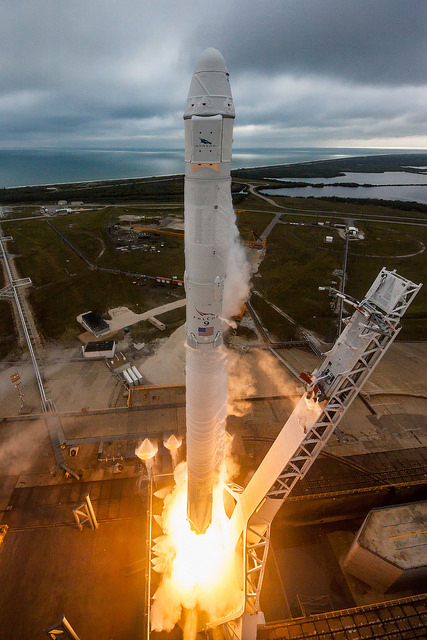 Liftoff of CRS-10 mssion. NIce view of Falcon 9, Dragon capsule, and location of solar arrays on third stage. Credit Flickr. Courtesy of SpaceX who has placed their photos in the public domain.