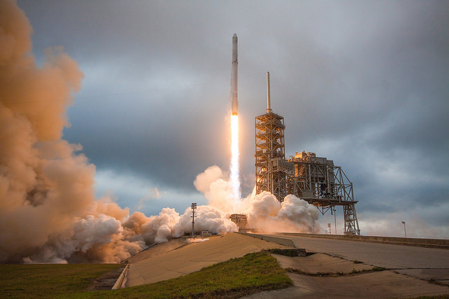 Falcon 9 and Dragon capsule launch. Add two more boosters, an upgraded Dragon 2 capsule, and imagine what could be done. Credit Flickr. Courtesy of SpaceX who has placed their photos in the public domain.