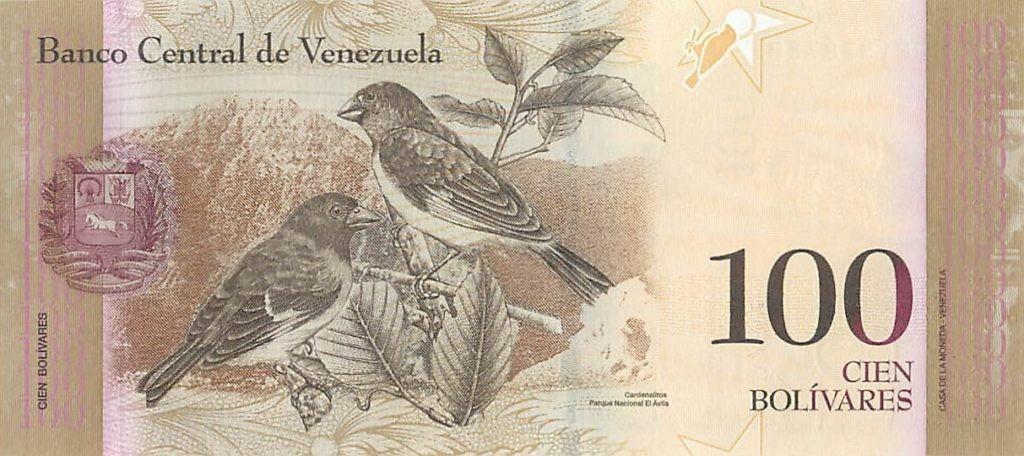 This image has an empty alt attribute; its file name is 100-bolivares-reverse-1024x456.jpg